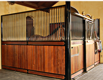 High Stall Front 12: Stall design with bar top; wood bottom; Euro-style center and bottom rails; swivel feeder; and V-yoke.