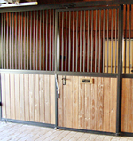 High Stall Front 23: Stall design with bar top; and wood bottom.