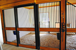 High Stall Front 30: Stall design with bar top; 45-degree crosshatch mesh bottom; wood center and bottom rails; wide door framing; and feed hole.