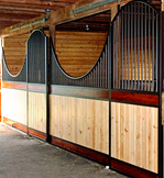 High Stall Front 45: Stall design with bar top; two-toned wood bottom; Euro-style center and bottom rails; arched door; and swooping panels.