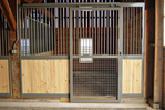 High Stall Front 48: Stall design with bar top; wood and crosshatch mesh bottom; and integrated gravity latch.