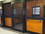 High Stall Front 49: Stall design with bar top; wood and 45-degree crosshatch mesh bottom; Euro-style center and bottom rails; arched door; V-yoke; and feed door.