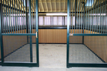 High Stall Front 56: Stall design with bar top; crosshatch mesh bottom; and electric access integrated into stall front.