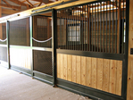 High Stall Front 74: Stall design with bar top; wood bottom; extra wide center rail; bedding guard; and low yoke.