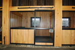 High Stall Front 87: Stall design with bar top; wood and crosshatch mesh bottom; and wood bottom rails in door.